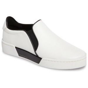 Michael KORS new slip on  SZ 9.5.   White/ Black